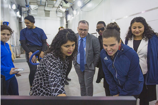 Dr. Shilpa Dogra, Associate Professor and Director of Kinesiology, Faculty of Health Sciences (front left) with The Honourable Kirsty Duncan, Minister of Science and Sport (front right) at Ontario Tech University's ACE (February 11, 2019). Onlooking are Dr. Steven Murphy, President, Ontario Tech University; Celina Caesar-Chavannes, Whitby MP (both in centre-back), and (right) The Honourable Maryam Monsef, Minister for Women and Gender Equality (also Minister of International Development as of March 1, 2019).