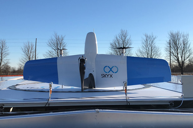 SkyX drone on an xStation drone charging platform prior to vertical take-off deployment.