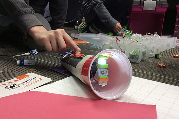 Participants using a LittleBits snappable circuit kit to create a flashlight during a previous March Break Maker Camp at Ontario Tech University.