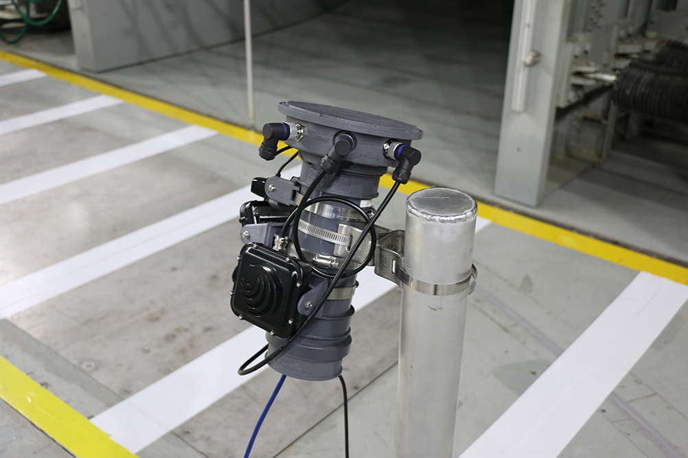 SmartCone hardware equipped with radar and lidar (light detection) sensors mounted in front of a mock crosswalk in the ACE Climatic Wind Tunnel to detect a pedestrian's walking speed.