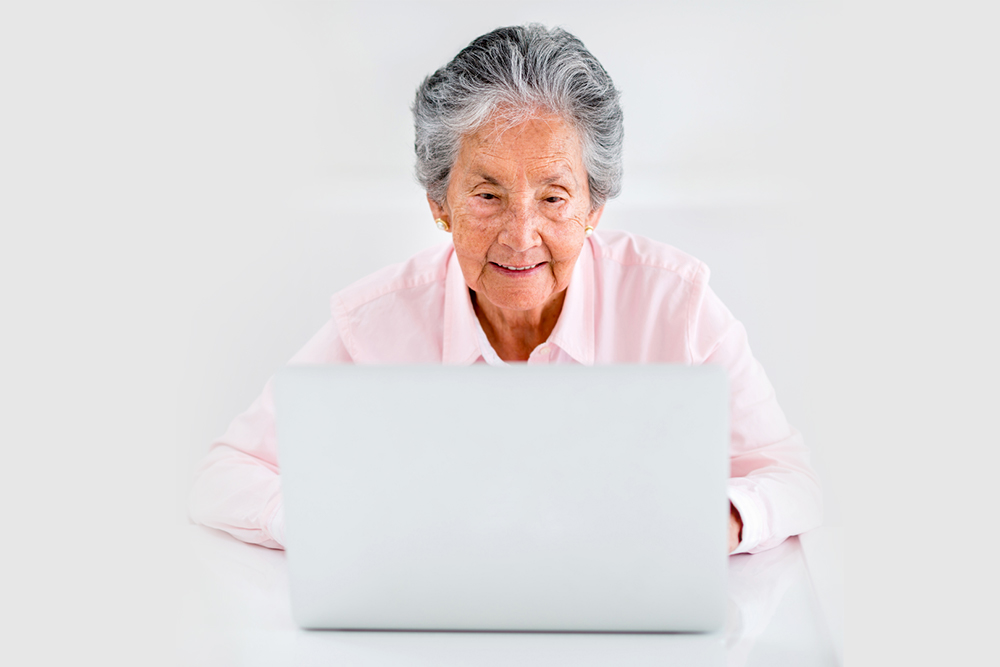 image of older adult using a laptop