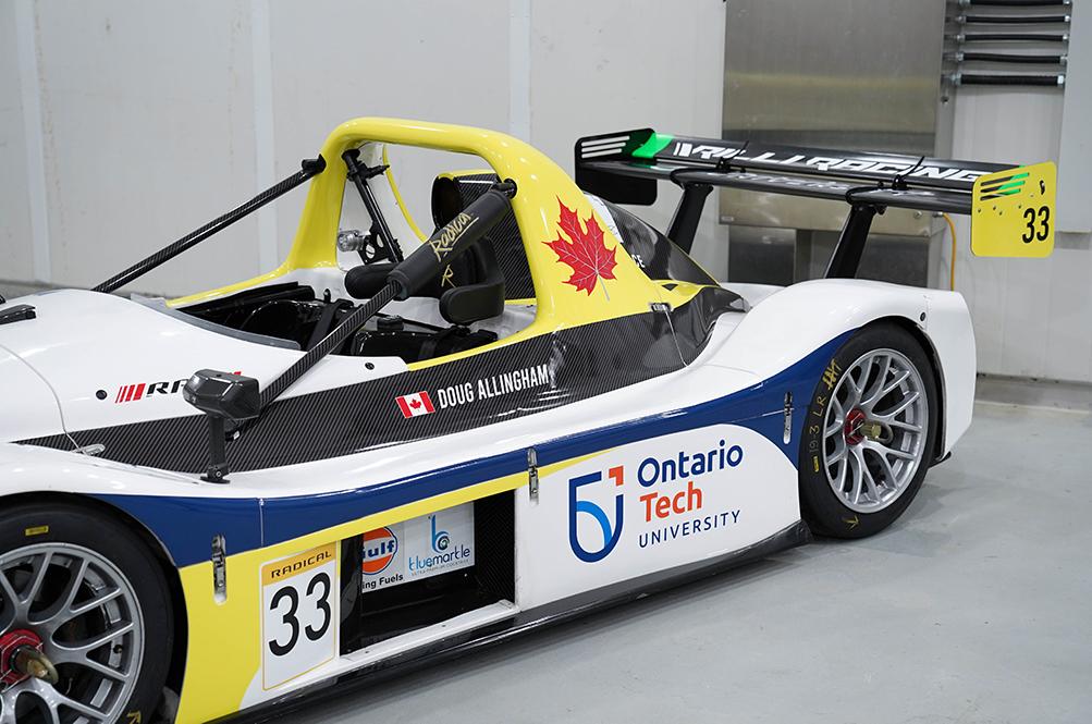 race car depicting Ontario Tech logo