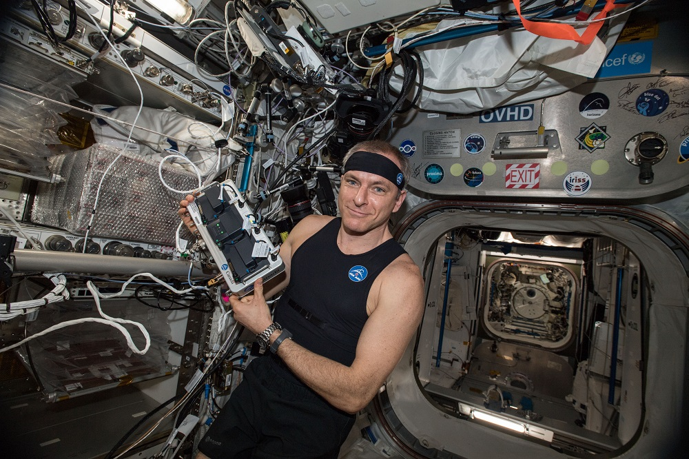 Canadian Space Agency astronaut David Saint-Jacques tries the Bio-Monitor, a new Canadian technology, for the first time in space. The innovative smart shirt system is designed to measure and record astronauts' vital signs. (Credit: Canadian Space Agency/NASA).