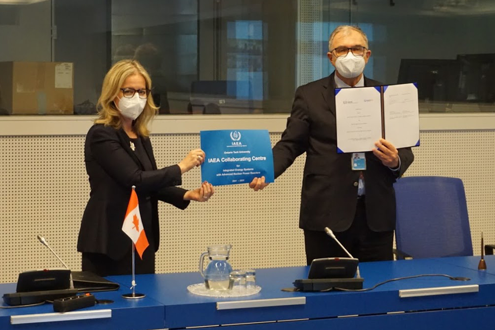 Heidi Hulan, Ambassador of Canada to Austria, and Chair, IAEA Board of Governors (left) and Mikhail Chudakov, IAEA Deputy Director General and Head of the Department of Nuclear Energy hold plaque confirming Ontario Tech University's designation as an IAEA Collaborating Centre (virtual ceremony in Vienna, Austria, April 22, 2021).